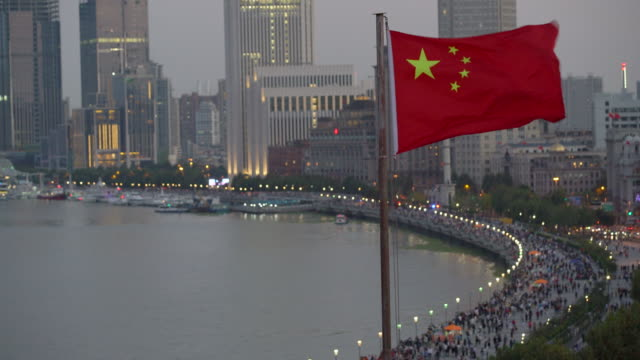 ws chinese flag waving in the wind, shanghai, china - chinese flag stock videos & royalty-free footage