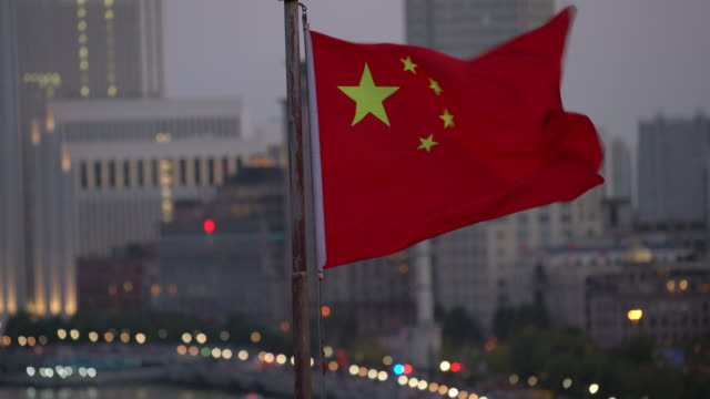 cu chinese flag waving in the wind, shanghai - chinese flag stock videos and b-roll footage