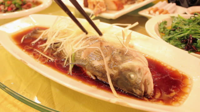 cu chinese food-fomfret/xian,shaanxi,china - chinese culture stock videos & royalty-free footage