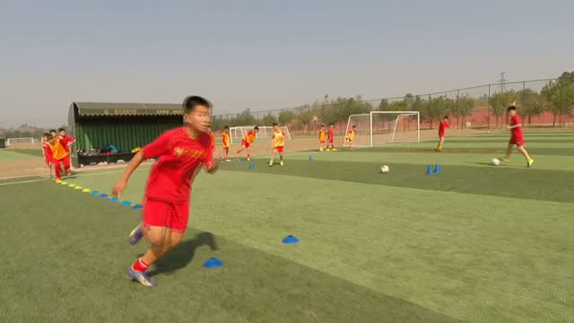 Chinese Football Academy Has World Cup Goals Showing Exterior shots boys pupils students at Evergrande International Football School on March 24 2016...