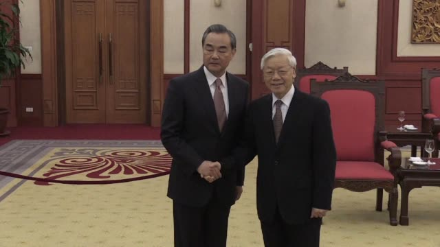 chinese foreign minister wang yi meets with vietnam's communist party general secretary nguyen phu trong and prime minister nguyen xuan phuc during... - communist party stock videos and b-roll footage