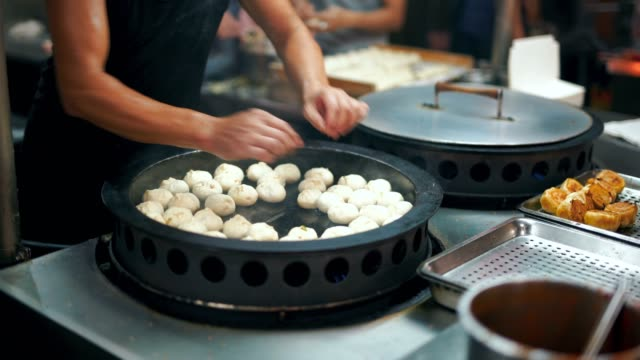chinese fried buns at saucepan vegan - taiwan stock videos and b-roll footage