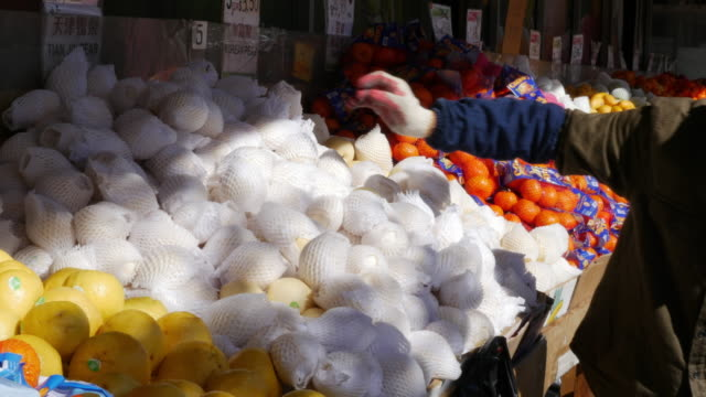 Chinese fruits vendors in Flushing, Queens, New York
