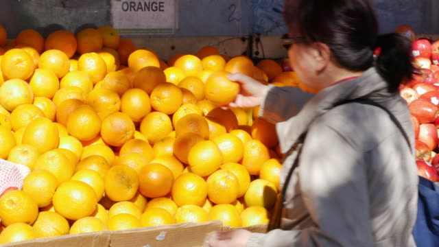 chinese fruits vendors in flushing, queens, new york - citrus fruit stock videos and b-roll footage