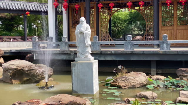 chinese garden with confuzius statue - classical chinese garden stock videos & royalty-free footage