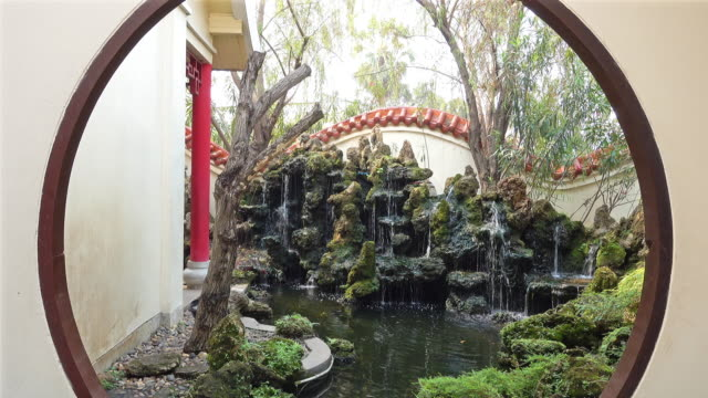 chinese garden with waterfall - show garden stock videos & royalty-free footage