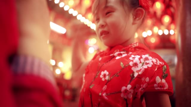 chinese girl playing with her mother in chinese new year festival - chinese culture stock videos & royalty-free footage
