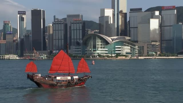 chinese government issues stark warning to protesters; china: hong kong: ext junk along in hong kong harbour with skyscrapers lining the harbour... - passenger ship stock videos & royalty-free footage