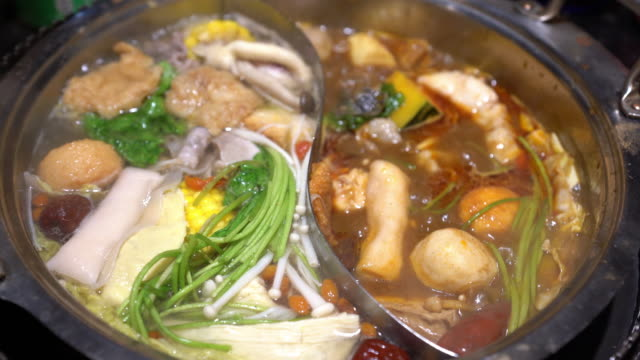 chinese hot pot, mala hot pot - overflowing stock videos & royalty-free footage
