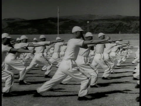 chinese in filled stadium vs men in line practicing martial arts playing tugofwar diving into public swimming pool ha ws pool vs people playing in... - 1937 stock videos and b-roll footage