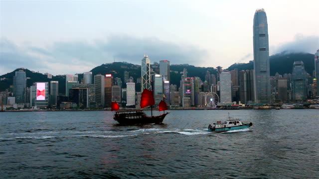 chinese junk boat sailing on victoria harbor in hong kong - hong kong island stock videos & royalty-free footage