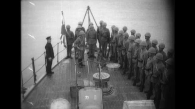 chinese land forces assemble on the deck of a battleship on the yangtze river before landing to fire machine guns and attack enemy pillboxes during... - battleship stock videos & royalty-free footage