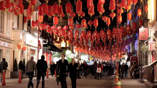 ws, chinese lanterns hanging above gerrard street, chinatown, london, england - chinese new year stock videos & royalty-free footage