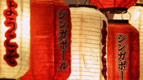 cu chinese lanterns hanging as decoration at night / singapore - small group of objects stock videos & royalty-free footage