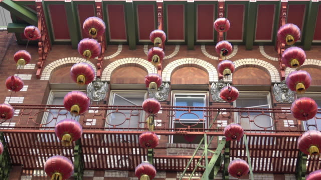 chinese lanterns hanging from building exterior in san francisco chinatown - chinese culture stock videos & royalty-free footage