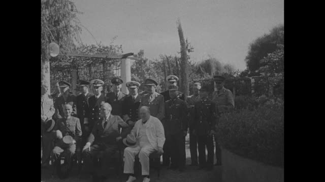 stockvideo's en b-roll-footage met vs chinese leader general chiang kaishek us president franklin d roosevelt and british prime minister winston churchill seated outdoors with military... - geallieerde mogendheden