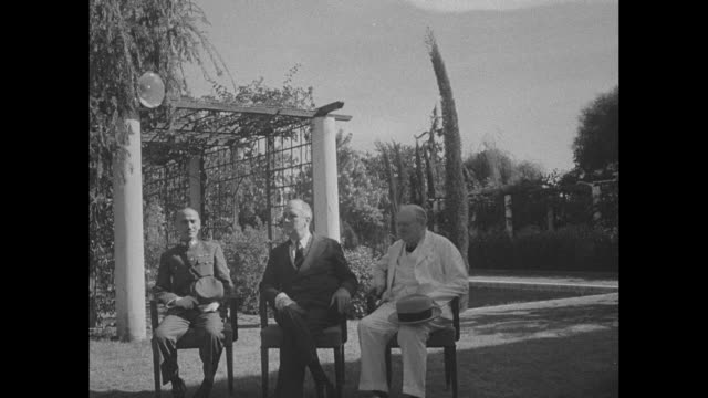 stockvideo's en b-roll-footage met cu chinese leader general chiang kaishek us president franklin d roosevelt and british prime minister winston churchill in front of garden arbor for... - geallieerde mogendheden