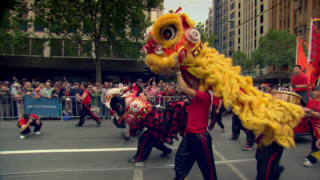 Chinese lions parade down a street in Melbourne to celebrate Australia Day.