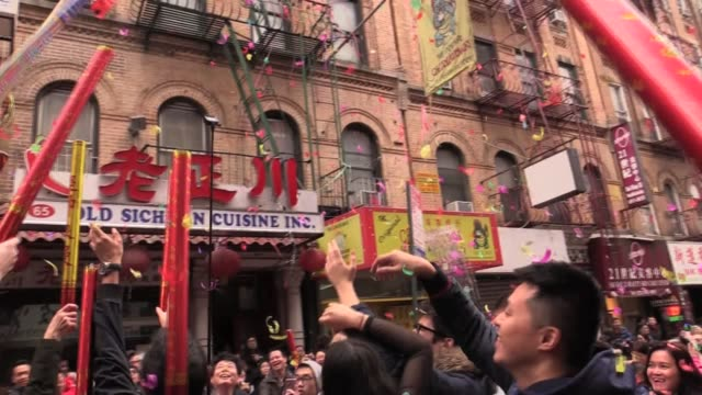 chinese lunar new year celebration in chinatown fireworks dragons blessing merchants for lucky money poppers and confetti year of the dog - decoration stock videos & royalty-free footage