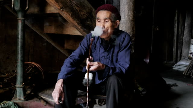 chinese man smoking pipe with a close up - tobacco product stock videos & royalty-free footage