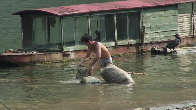 ms chinese man working in li river / guangxi, china - li river stock videos & royalty-free footage