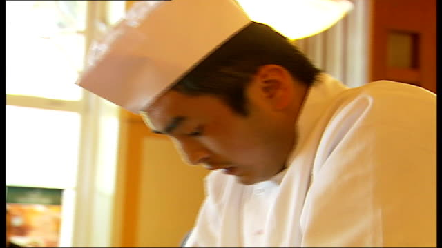 chinese masterchef competition run by westminster council; chinese chef kneading dough - masterchef stock videos & royalty-free footage