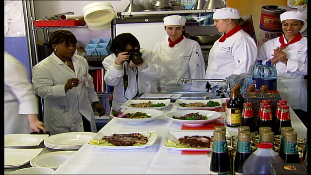 chinese masterchef competition run by westminster council; photographer taking pictures of the chinese food prepared during the competition - masterchef stock videos & royalty-free footage