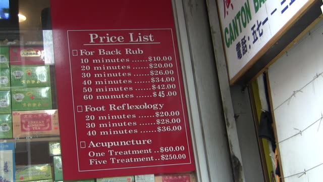 cu, chinese medicine price list chinatown, new york city, new york, usa - reflexology stock videos and b-roll footage