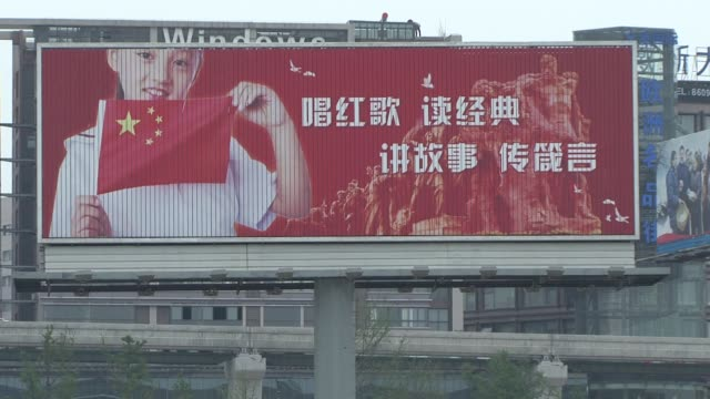 Chinese megacity bursts into red song mania CHONGQING China Residents of the southwestern metropolis of Chongqing are being encouraged to sing red...