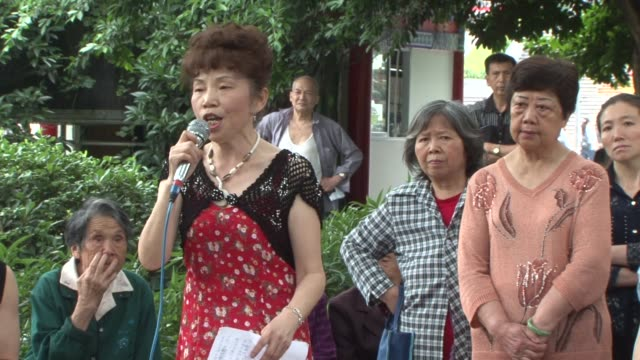 chinese megacity bursts into red song mania chongqing china residents of the southwestern metropolis of chongqing are being encouraged to sing red... - communist party stock videos and b-roll footage