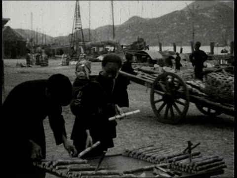 ms chinese men and woman work unloading cargo from boats people buying and eating food at outdoor kitchens and food vendors / hong kong - retail occupation stock videos & royalty-free footage