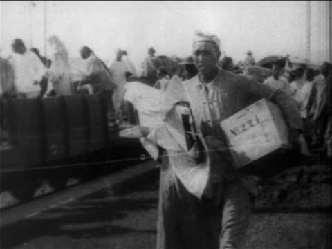 chinese men with bags walking by train during boxer rebellion, china / newsreel - chinese ethnicity stock videos & royalty-free footage