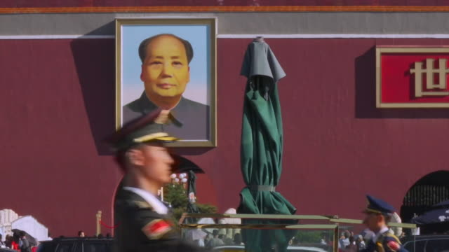 chinese military personnel marching outside the great hall of the people in beijing - marching stock videos and b-roll footage