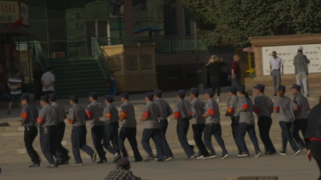 chinese military personnel outside empty uighur mosques in xinjiang china - xinjiang province stock videos & royalty-free footage