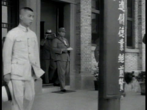 china chinese military political leader chiang kaishek in uniform walking out of building saluting school children bowing chiang kaishek walking w/... - chiang kai shek stock videos and b-roll footage