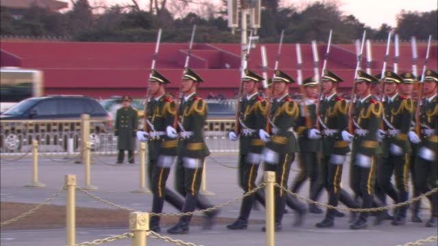 a chinese military unit marches to take position in a ceremony before tiananmen square. - tiananmen square stock videos and b-roll footage