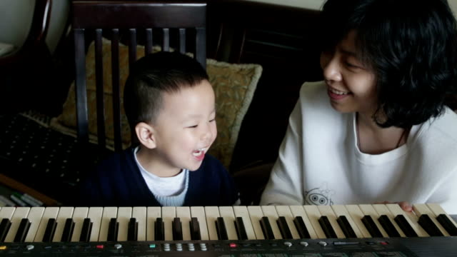 chinese mother teaching her son how to play piano - 2 3 years stock videos and b-roll footage