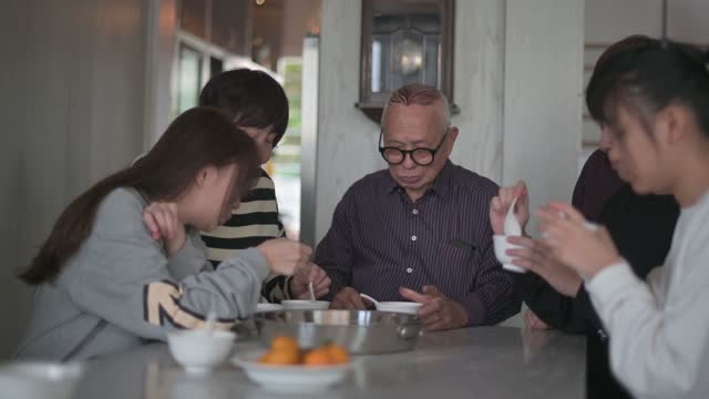 chinese multi generation family enjoying glutinous rice ball tang yuan dessert during winter solstice chinese new year festival - solstice stock videos & royalty-free footage
