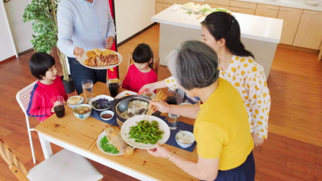 chinese multi-generation family eating new years food - dining table stock videos & royalty-free footage