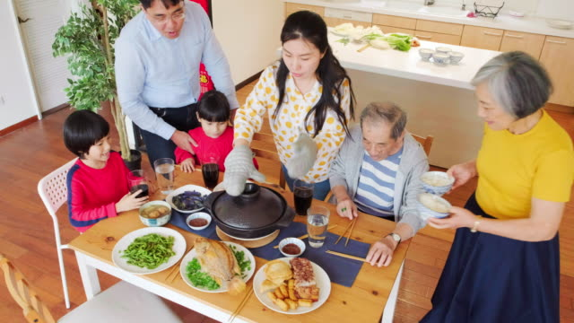 chinese multi-generation family eating new years food - chinese new year stock videos & royalty-free footage