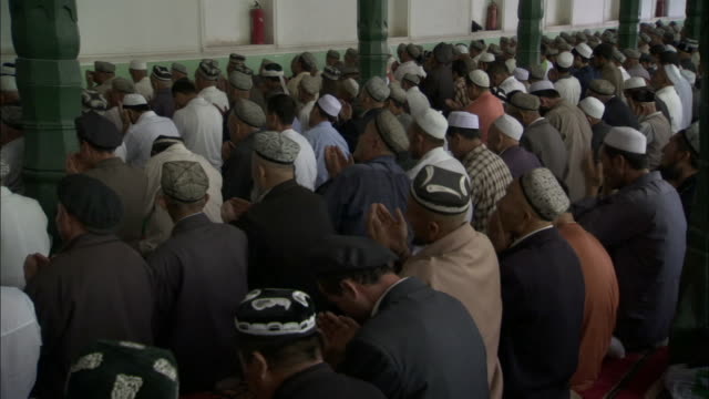 chinese muslims at prayer, kashgar, xinjiang province, china, - xinjiang province stock videos & royalty-free footage