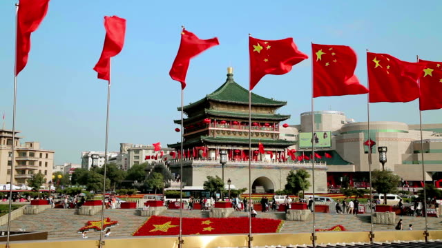chinese national flags and drum tower during national day holiday in china. - chinese flag stock videos and b-roll footage
