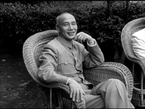 chinese nationalist generalissimo chiang kai-shek sitting w/ governor of new york thomas e. dewey & wife madame chang in wicker chairs on porch w/... - chiang kai shek stock videos & royalty-free footage