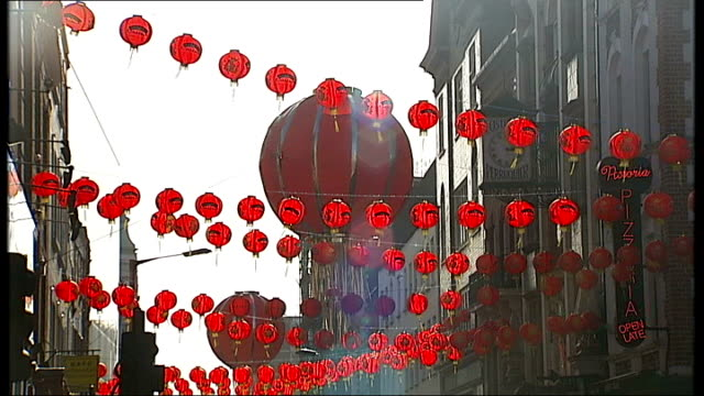 chinese new year 2014: celebrations in london; low angle shot red chinese lanterns across street in soho, china town - lantern stock videos & royalty-free footage