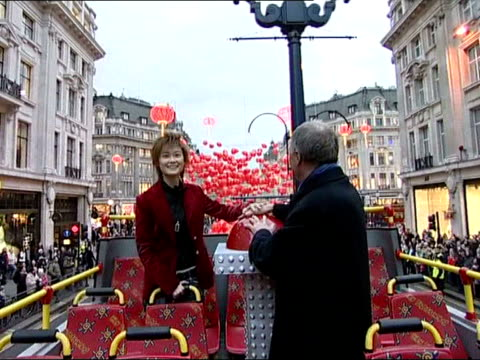 chinese new year celebrations in london/'china in london' launched london mayor ken livingstone posing on open top bus with chinese pop idol li... - chinesisches laternenfest stock-videos und b-roll-filmmaterial