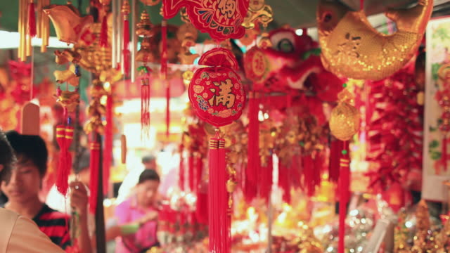 cu chinese new year decoration on market stall / samphanthawong, bangkok, thailand - souvenir stock videos and b-roll footage