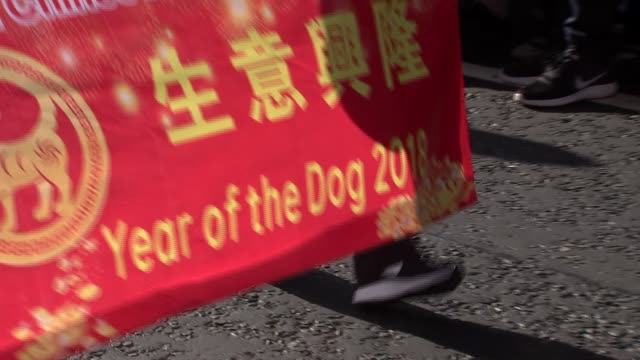 chinese new year parade in london to celebrate start of 'year of the dog' england london ext various of chinese new year parade through london... - chinese new year stock videos & royalty-free footage