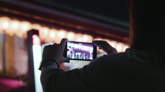 Chinese new year woman uses a smartphone to video view