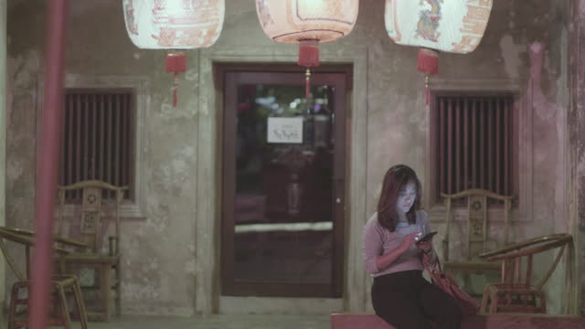 chinese new year woman uses a smartphone - taiwan stock videos & royalty-free footage