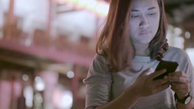 chinese new year woman uses a smartphone - taiwan stock videos and b-roll footage